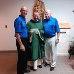 Grand Knight and Advocate present 1500.00 to Father Tom for new Chairs and Tables